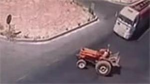 Tractor flipped by truck