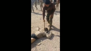 Soldier Axes Daesh Head